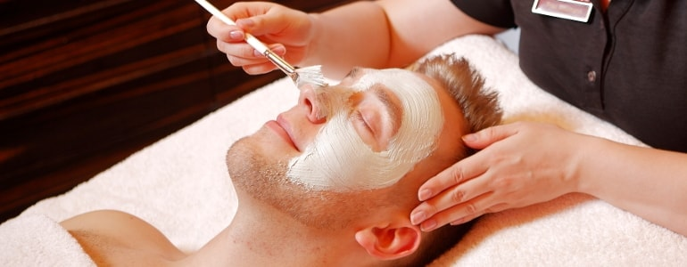 Men gets a facial treatment